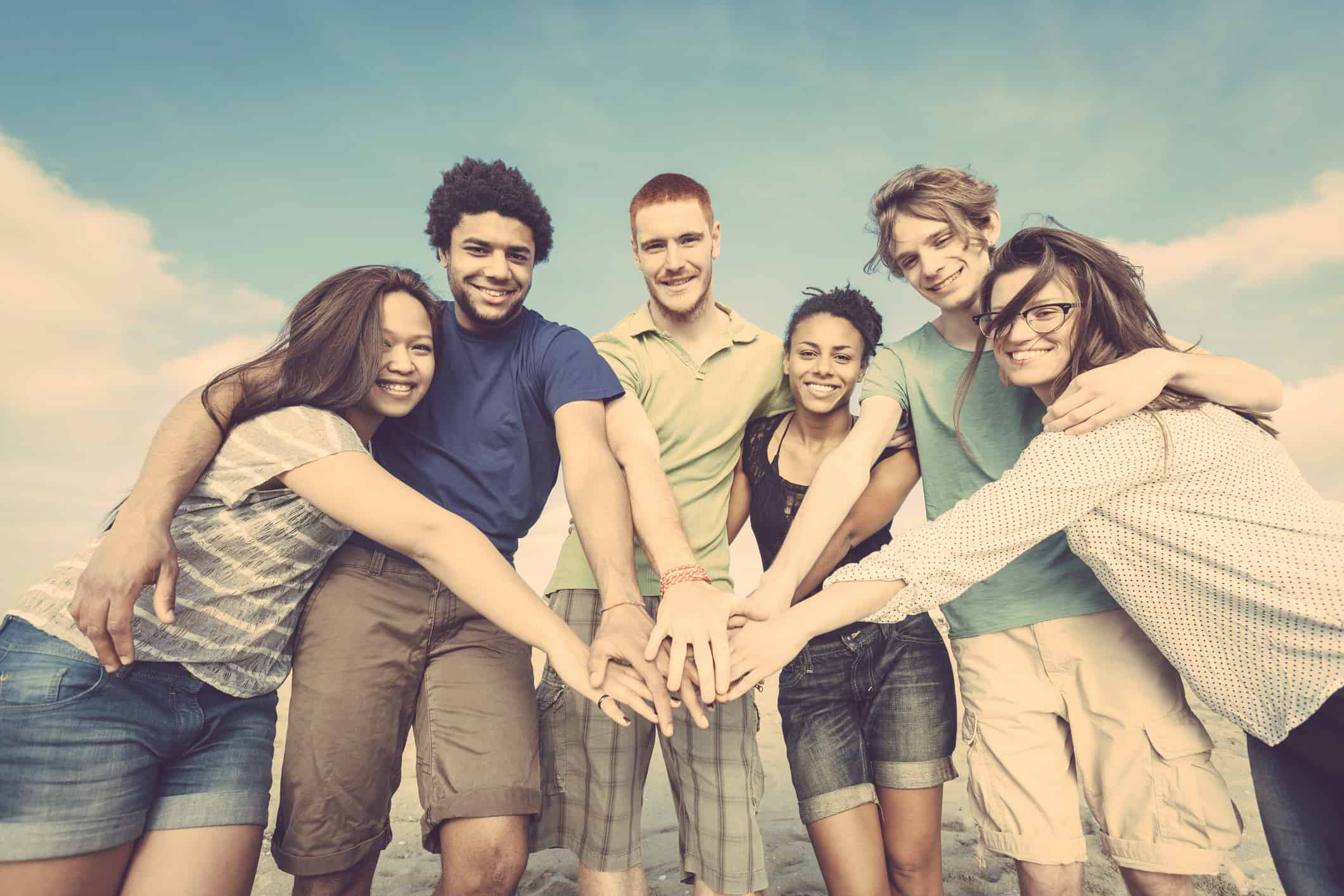 Multiracial Group of Friends with Hands on Stack