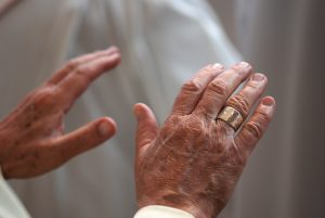 Hands of a Priest Praying