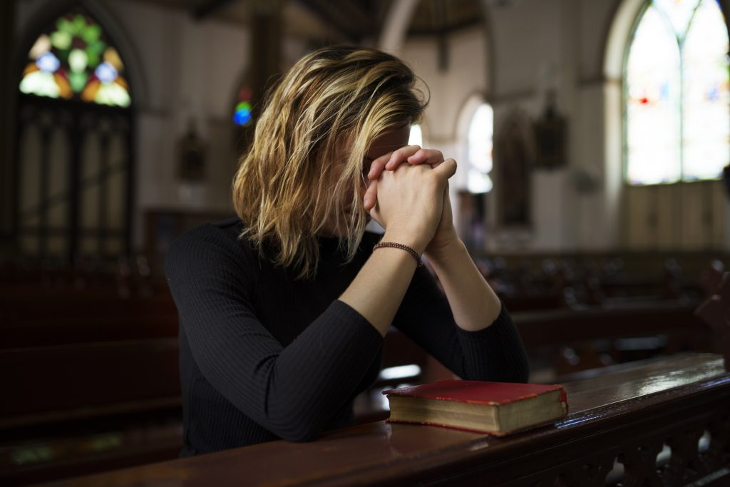 Woman sitting in Church Praying